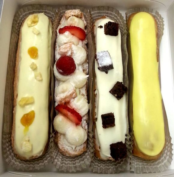 Pineapple, Cheesecake, Brownie, and Passion Fruit Eclairs from Éclair Bakery - Photo Courtesy of Éclair Bakery (NYC)