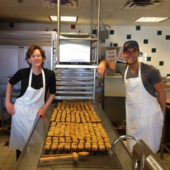 Ellen (Ella) and Casey by the production line - Photo Courtesy of E&C's Snacks (Eden Prairie, MN)
